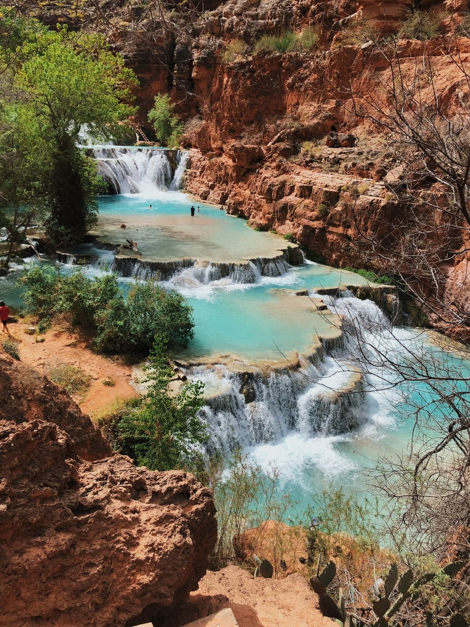 Cascading turquoise blue waterfalls on your hike in past Havasu Falls to Beaver Falls