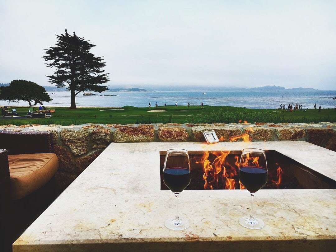 Enjoy the views and a glass of wine at the 19th hole at Pebble Beach Resort in California