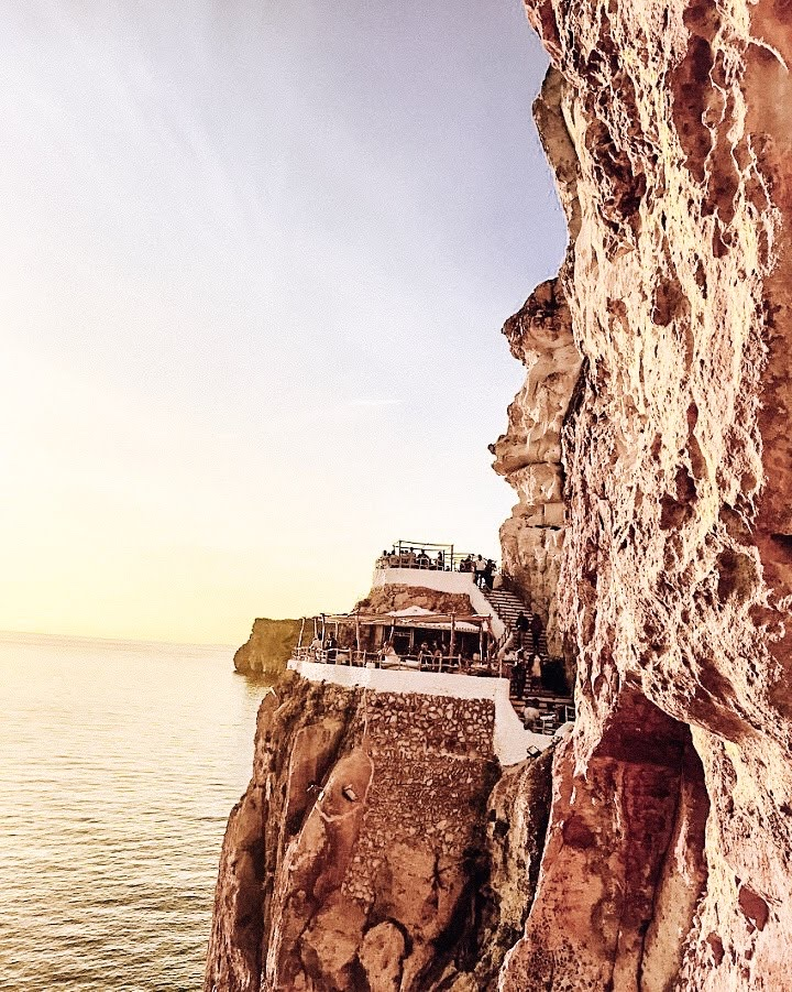 One of the most unique cliffside cocktails bars and best places to catch the sunset on the island of Menorca