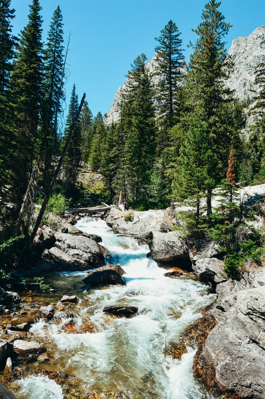 Waterfalls and rushing creeks on the hike around Jenny Lake in Tetons national park