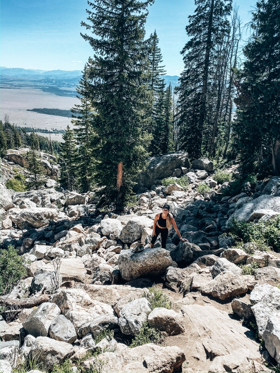 Scrambling up the boulder fields on the Delta Lake Trail in Teton National Park