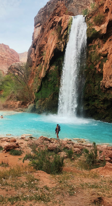 Standing at the bottom of Havasupai Falls after the 10 mile hike in