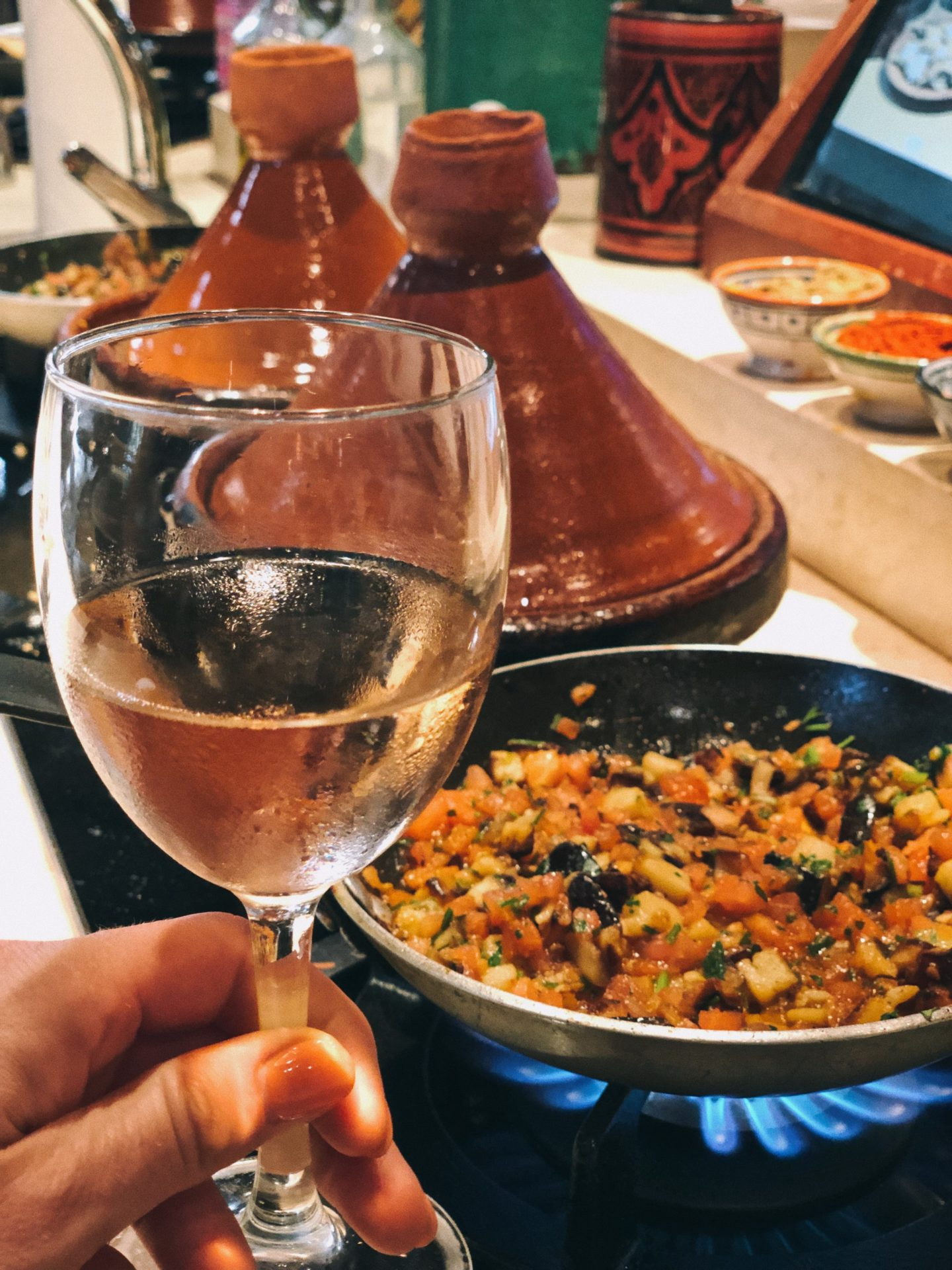 Sipping a cold glass of rose while making traditional Moroccan cuisine at a cooking class in Morocco.