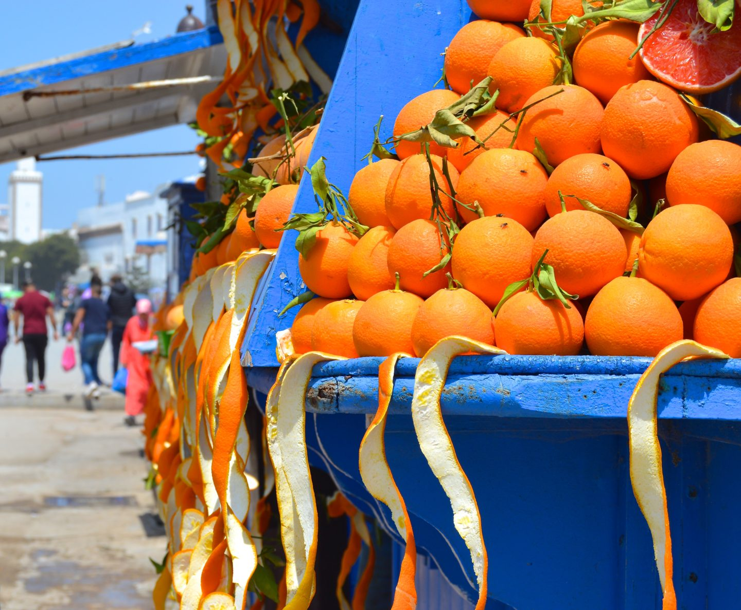 Plenty of oranges to go around. Fresh squeezed orange juice available while walking down the coastal alleyway.