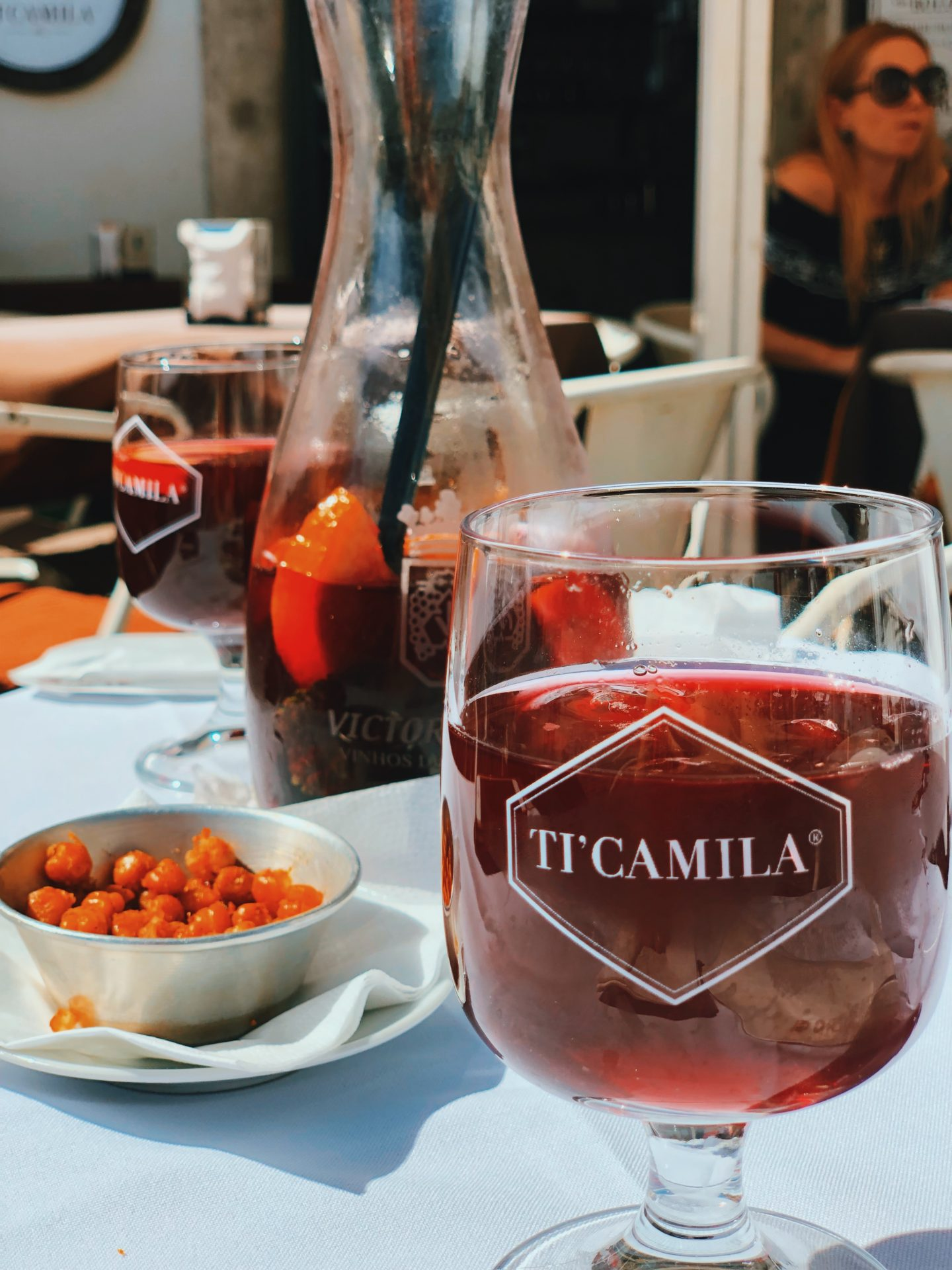 Sangria and baked chickapeas after a hectic and stressful travel day on the side streets of Lisbon Portugal