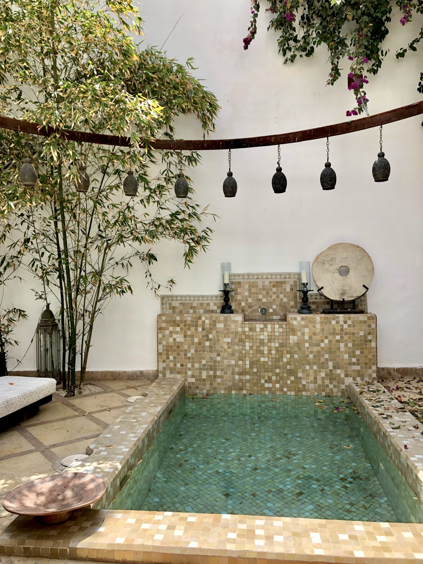 The beautiful and serene pool and courtyard set up at Riad Dyor
