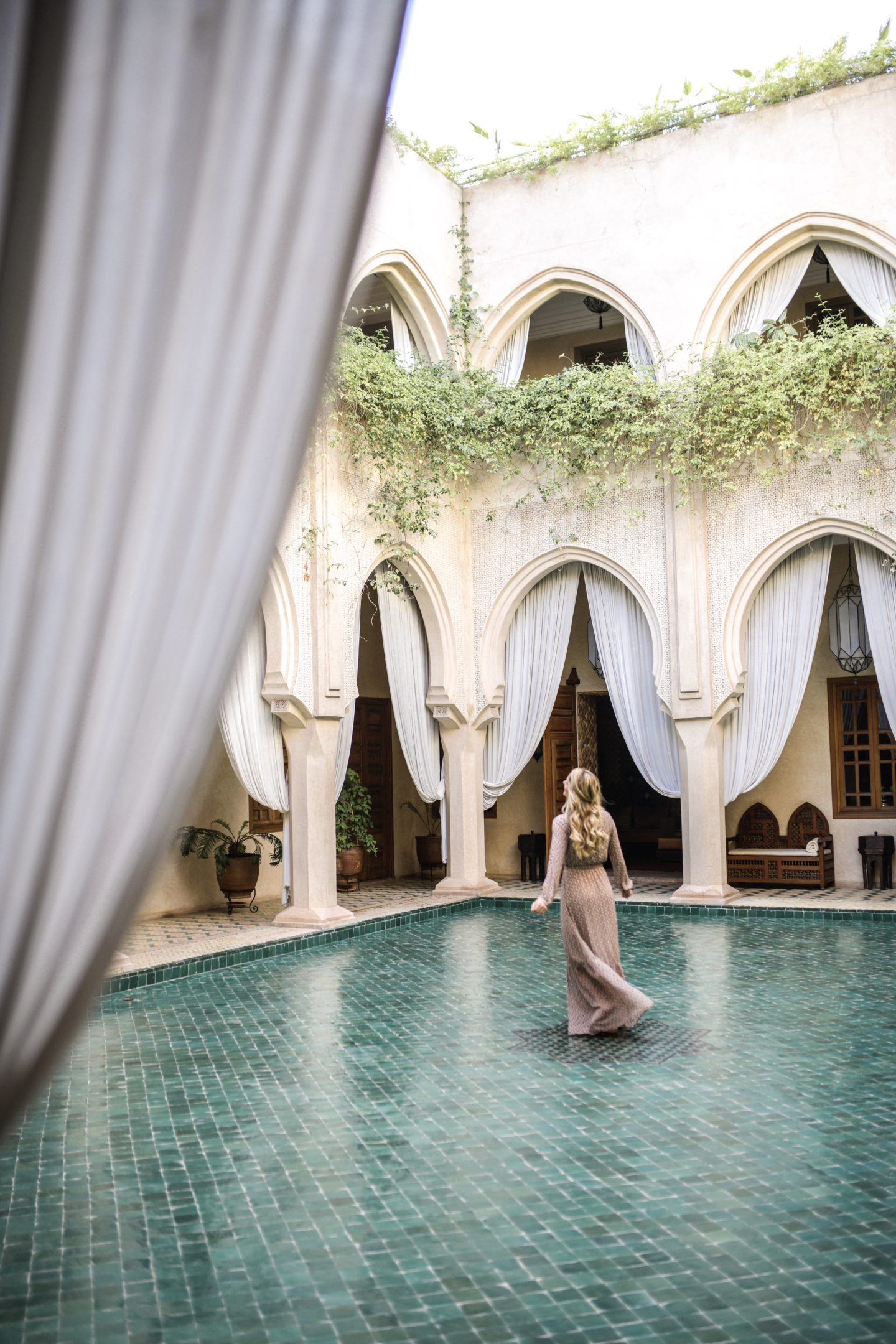 "Twirling around the center of the most gorgeous riad ""hotel"" stay in Marrakech Morocco."