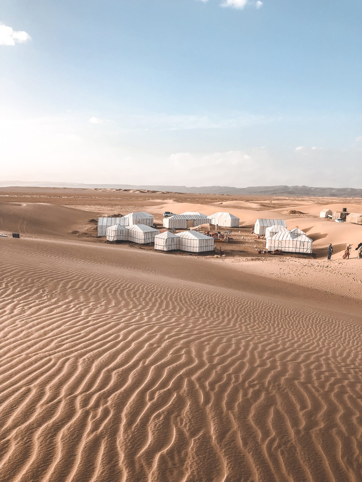 Our glamping site in the middle of absolutely nowhere in the Saharan Desert of Morocco during golden hour.