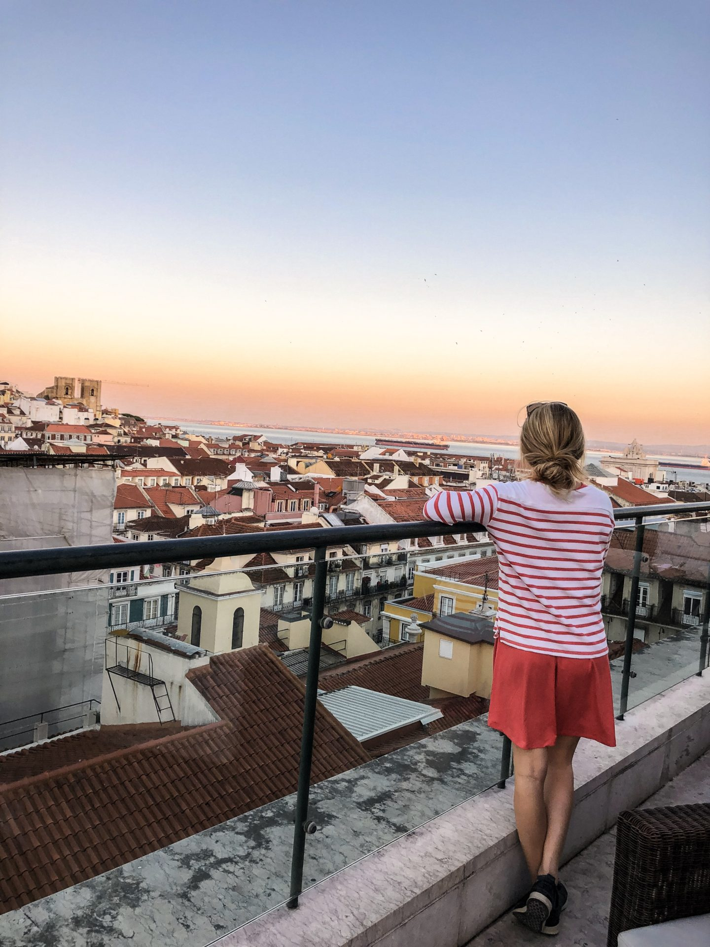 Rooftop views overlooking the sunset on our first evening in Lisbon Portugal after a crazy travel day