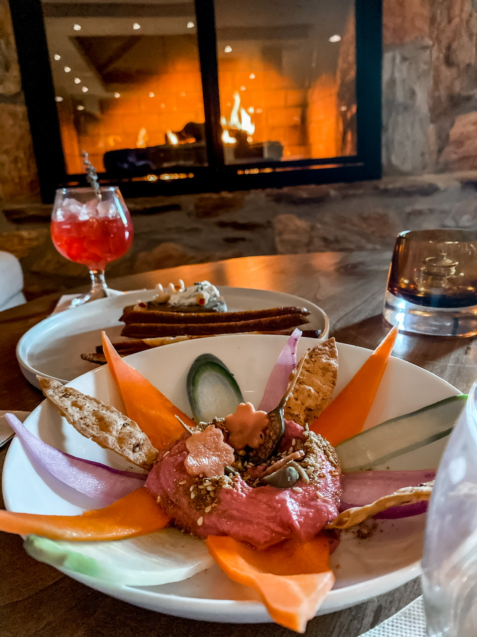 Enjoying Happiness Hour with mushroom-lentil pate, beet hummus and mocktails by the fire at Civana Terras Bar!