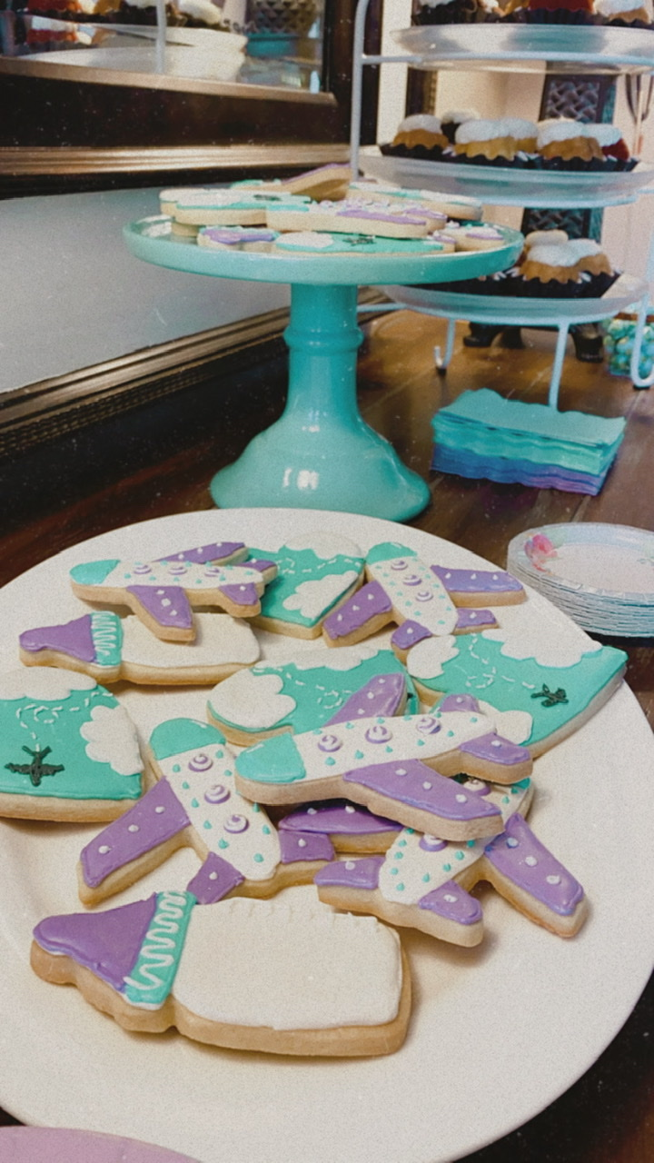 travel and adventure awaits themed baby shower cookies