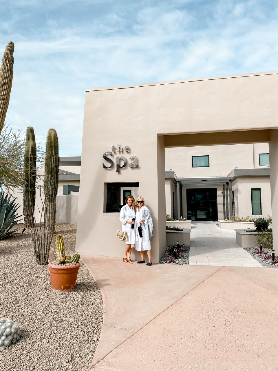 Standing outside the welcoming oasis that is the Civana Spa before enjoying our signature facial and prenatal massages.
