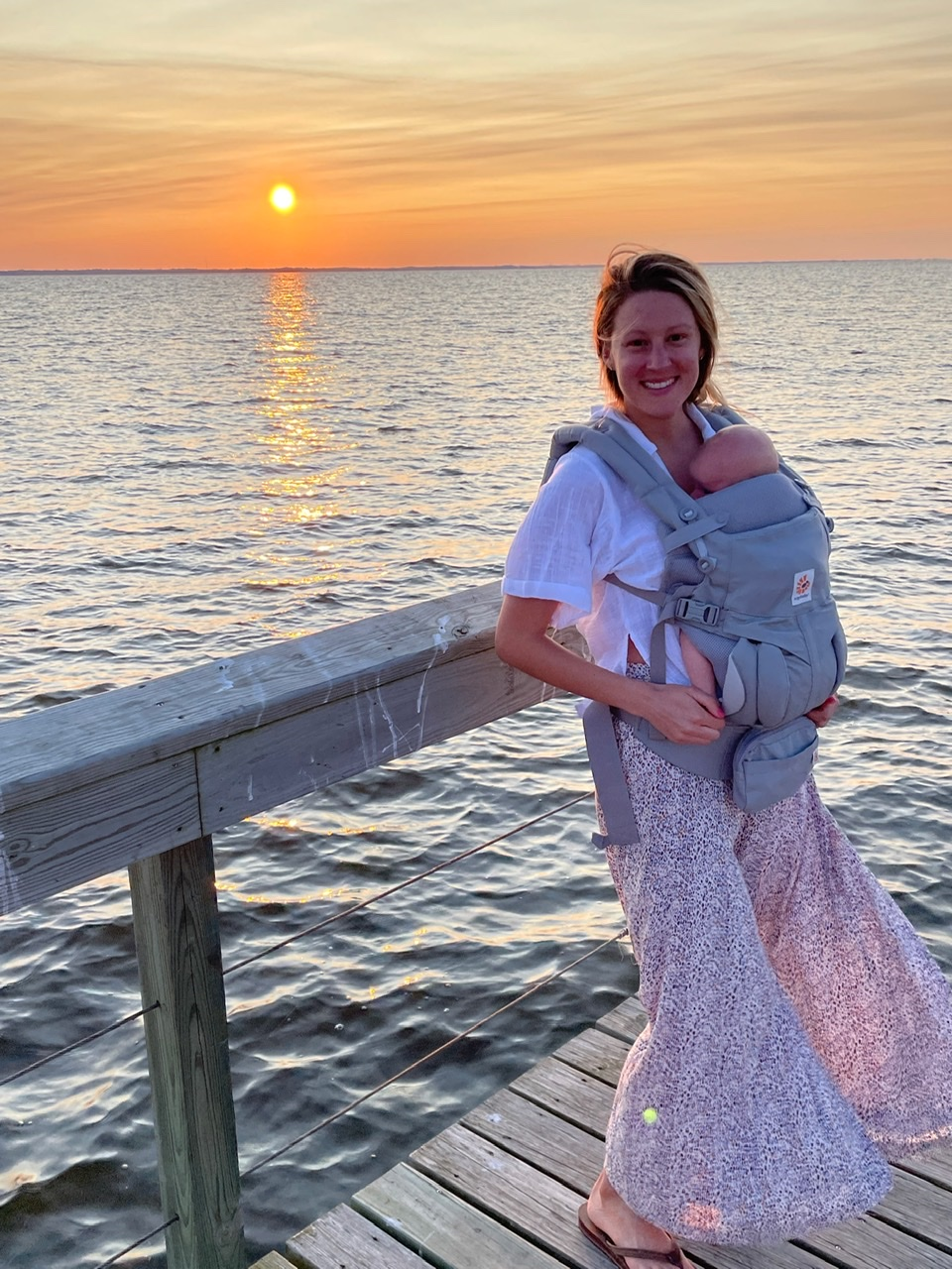 Staying up past bedtime thanks to my ergobaby carrier which makes travel and getting off routine with a baby much easier!